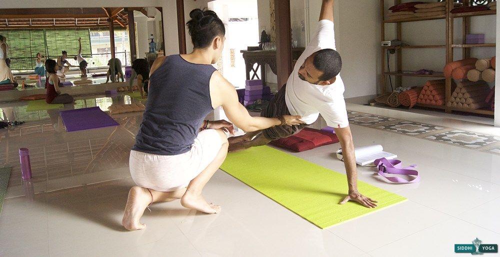 assisting yoga class