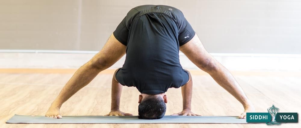Standing Wide-Legged Forward Bend pose