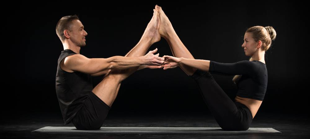yoga for two people supported boat pose