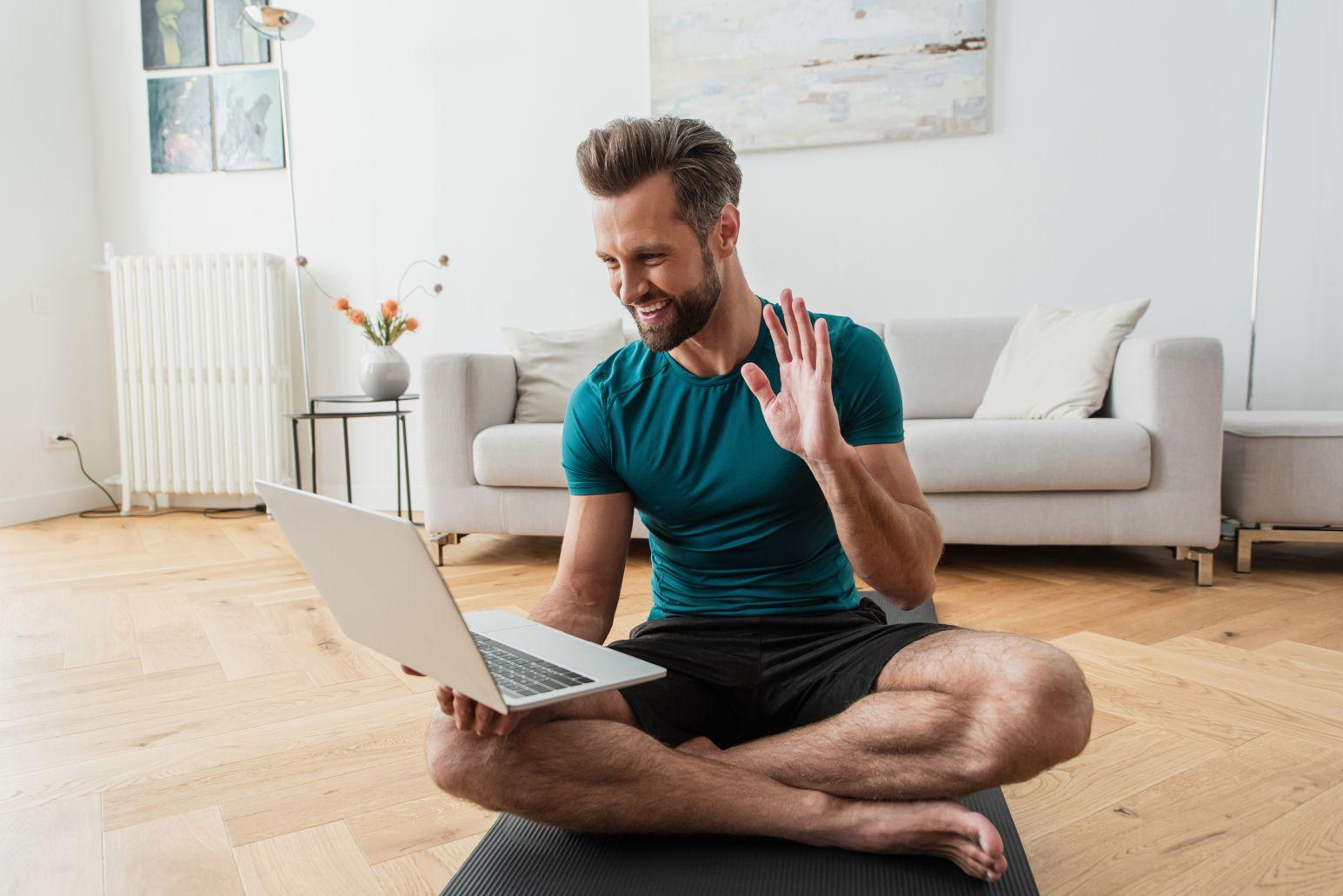 Online Yoga YTT Student Smiling With Laptop
