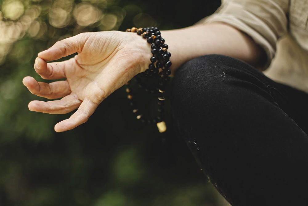 mala beads symbol hand